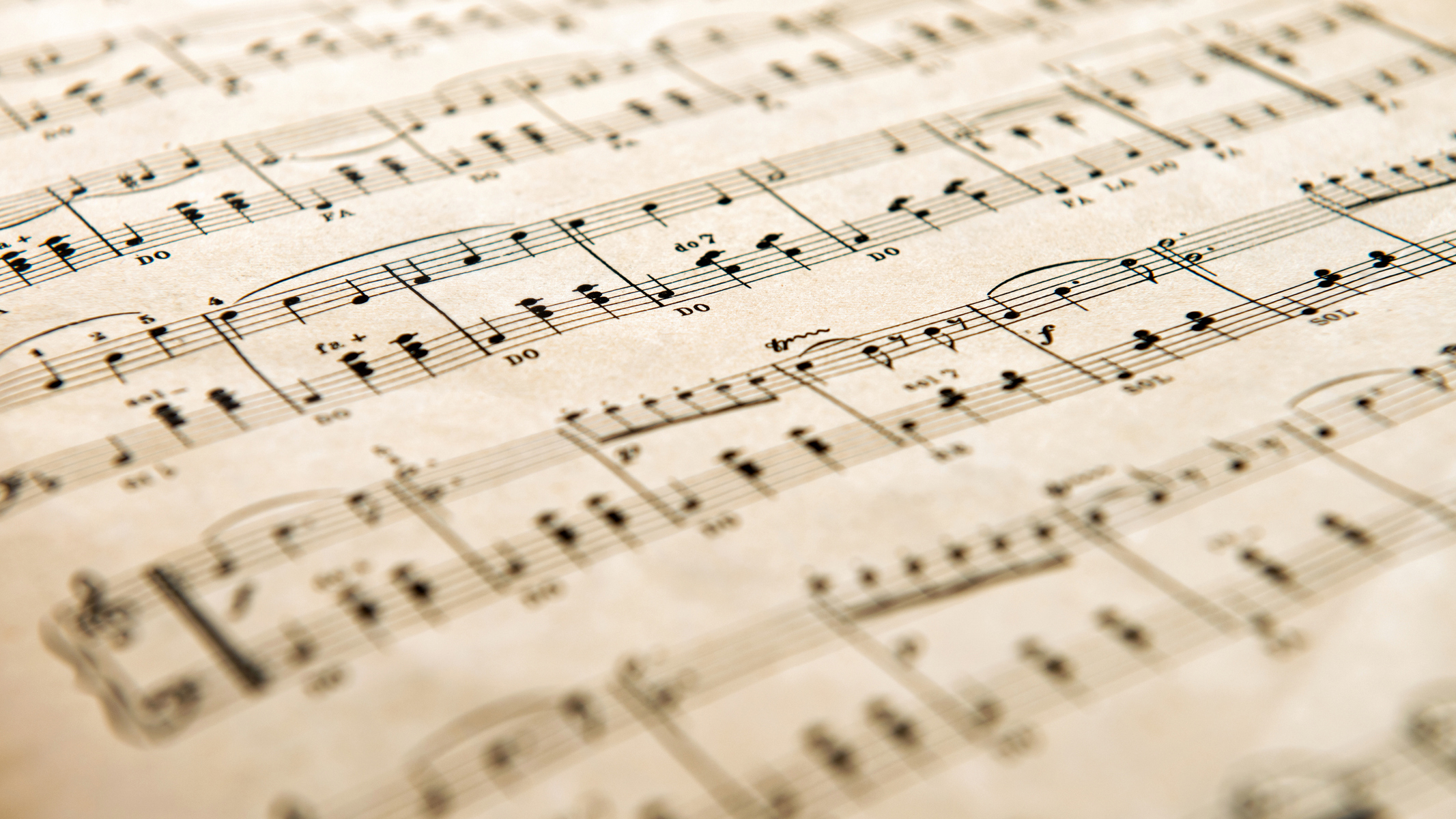 Low angle view of an old yellowed aged music score with shallow dof